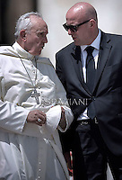 Pope Francis  Domenico Giani personal bodyguard the Pope. leads a mass in St Peter's square for the canonization of four blessed nuns, whose two lived in Ottoman Palestine, on May 17, 2015 in Vatican. Pope Francis will declare four nuns as Saints today, two nuns from Palestine St Marie Alphonsine Ghattas from Jerusalem and St Mariam Bawardy from Ibilin village in the Galilee, both of whom lived in the 19th century, St Emilie de Villeneuve from France and St Maria Cristina of the Immaculate Conception from Italy