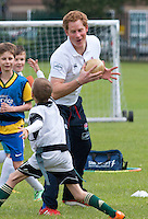 Prince Harry plays Tag-Rugby with young children - UK