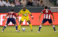 Columbus Crew forward Emilio Renteria (20) guarded tightly by Chivas USA players Michael Umana (4) and Ante Jazic (6) as he moves with the ball. CD Chivas USA defeated the Columbus Crew 3-1 at Home Depot Center stadium in Carson, California on Saturday July 31, 2010.