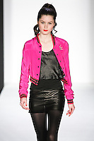 Magenta walks runway in a bebeBlack Fall 2011 outfit, at the Style 360 Fall 2011 fashion show, during New York Fashion Week.