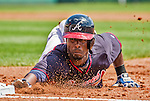 21 March 2015: Atlanta Braves infielder Pedro Ciriaco dives safely back to first during a Split Squad Spring Training game against the Washington Nationals at Champion Stadium at the ESPN Wide World of Sports Complex in Kissimmee, Florida. The Braves defeated the Nationals 5-2 in Grapefruit League play. Mandatory Credit: Ed Wolfstein Photo *** RAW (NEF) Image File Available ***