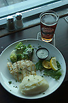 Alaska, Juneau: Dining in Juneau on the wharf and at the Hangar At The Wharf in front of the float plane dock.  Halibut at the Hangar. .Photo copyright Lee Foster, 510/549-2202, lee@fostertravel.com, www.fostertravel.com..