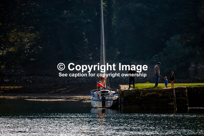 Strangford Lough, N Ireland, UK, yacht, jetty, people, adults, children, 200809271505..Copyright Image from Victor Patterson, 54 Dorchester Park, Belfast, UK, BT9 6RJ..Tel: +44 28 9066 1296.Mob: +44 7802 353836.Voicemail +44 20 8816 7153.Skype: victorpattersonbelfast.Email: victorpatterson@mac.com.Email: victorpatterson@ireland.com (back-up)..IMPORTANT: If you wish to use this image or any other of my images please go to www.victorpatterson.com and click on the Terms & Conditions. Then contact me by email or phone with the reference number(s) of the image(s) concerned.