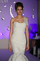 Model walks runway in a Jim Hjelm Blush Fall 2011 dress by Francesca Pitera, for the JLM Couture Fall 2011 Bridal fashion show.