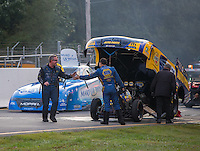 Oct 2, 2016; Mohnton, PA, USA; NHRA funny car driver Ron Capps (right) congratulates teammate Tommy Johnson Jr after Johnson won the Dodge Nationals at Maple Grove Raceway. Mandatory Credit: Mark J. Rebilas-USA TODAY Sports
