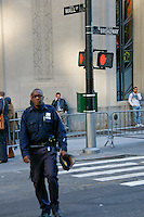 Cop patrols Wall Street & Broadway during the Occupy Wall Street Protest in New York City October 6, 2011.