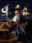 Pirate with a lantern opening a treasure chest full of gold and jewels
