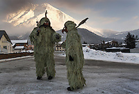 The Wild Ones don grotesque masks and suits of lichen gathered from the trees for an ancient Pagan tradition known as Schleicherlaufen held in the Tyrol of Austria since 1571.  The father and son's costumes are a symbol of winter which parallel's traditional celebration of Carnival.<br />