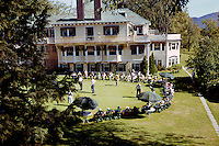 Bethel Inn in Bethel, Maine.  Large group gather to watch a putting contest. 1959 photograph.