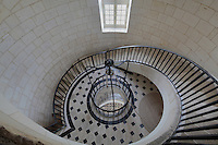 Looking down at the Salle du Contrepoids, with pulley, patterned marble floor and spiral staircase, built by Joseph Teulere in the 18th century, at the Phare de Cordouan or Cordouan Lighthouse, built 1584-1611 in Renaissance style by Louis de Foix, 1530-1604, French architect, located 7km at sea, near the mouth of the Gironde estuary, Aquitaine, France. This is the oldest lighthouse in France. There are 4 storeys, with keeper apartments and an entrance hall, King's apartments, chapel, secondary lantern and the lantern at the top at 68m. Parabolic lamps and lenses were added in the 18th and 19th centuries. The lighthouse is listed as a historic monument. Picture by Manuel Cohen