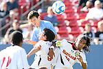 14 December 2008: UNC's Zach Loyd (facing, left) heads the ball over Maryland's Doug Rodkey (5) and A.J. Delagarza (20). The University of Maryland Terrapins defeated the University of North Carolina Tar Heels 1-0 at Pizza Hut Park in Frisco, TX in the championship game of the 2008 NCAA Division I Men's College Cup.