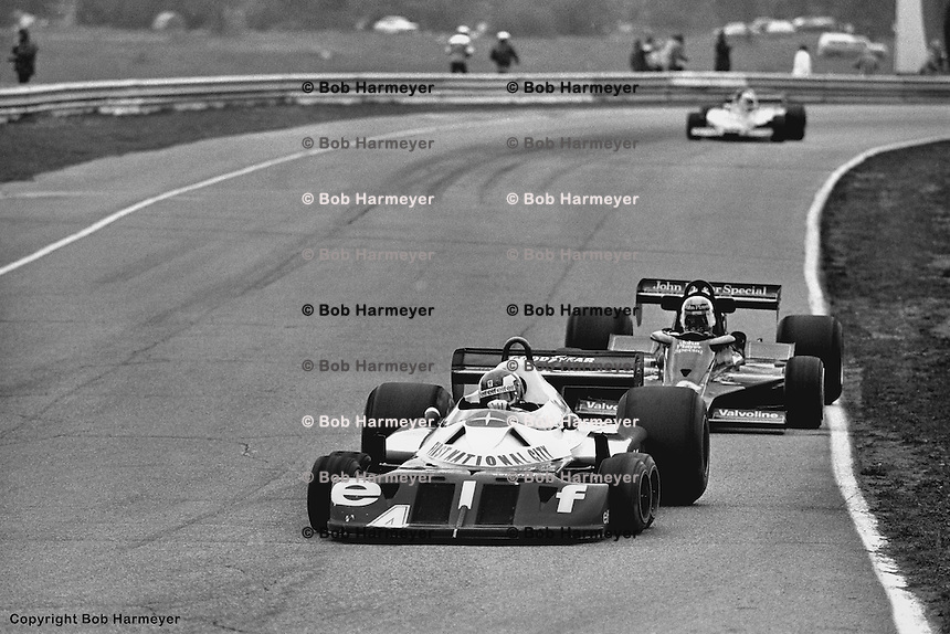 BOWMANVILLE, ONT: Patrick Depailler drives the Tyrrell P34 7/Ford Cosworth DFV ahead of Gunnar Nilsson in the Lotus 78 R4/Ford Cosworth DFV during the Canadian Grand Prix on October 9, 1977, at Mosport Park near Bowmanville, Ontario.