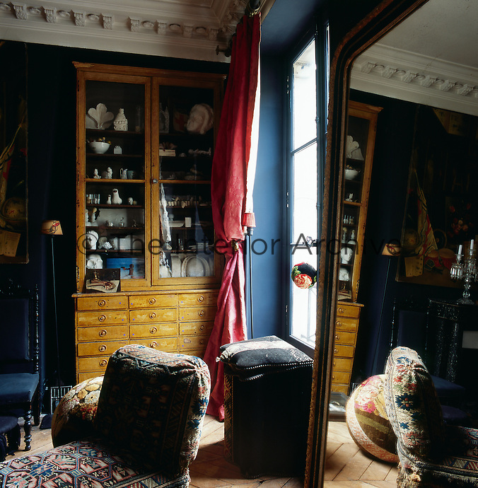 One of the rooms in the apartment of artist Frederique Morrel. The apartment where she lives is also her studio and a reflection of her work. She works with tapestry to create animal heads, human figures and other objects