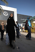 Locals shop at the Afra mall in Khartoum, Sudan, on Sunday, Apr. 15, 2007. Khartoum's first mall 'Afra' opened in 2004 and has become popular with affluent Sudanese..Khartoum is modeling itself as the Dubai of Africa and despite Western sanctions the city is booming. Away from the troubles and poverty that plaque the rest of Sudan, development in Khartoum is moving at an astonishing rate. Investment from the East, and in particular China, allowed the Sudanese economy to grow by 11% in 2007. This growth is driven largely by oil, with production rising from 63,000 barrels per day in 1999 to over 500,000 barrels today.