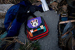 A Disney bag is found among the ruble after a massive tsunami that followed the March 11 magnitude 9 quake swept through the coastal town of Minami Sanriku, Miyagi Prefecture on 13 March, 2011.  Some 10,000 people of the town's 17,000 population are either dead or missing. Photographer: Robert Gilhooly