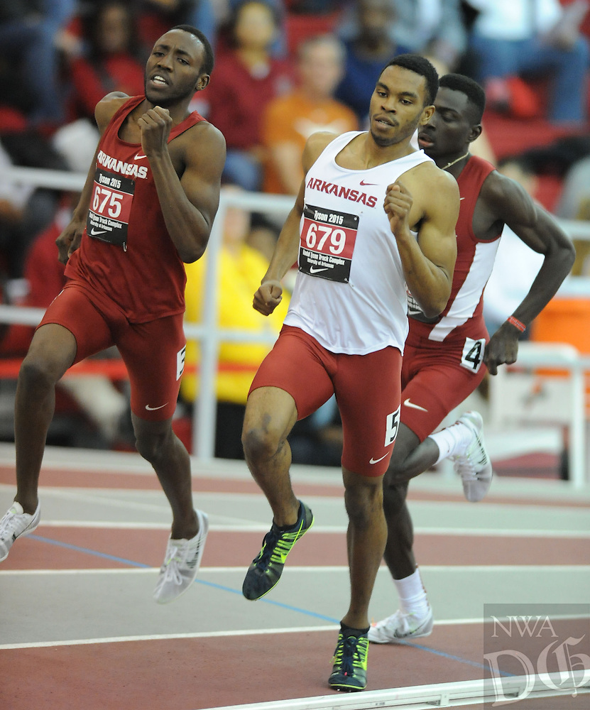 NWA Democrat-Gazette/ANDY SHUPE - Ryan Thomas of Arkansas rounds the first bend while competing in the 800 meters during the Tyson Invitational Friday, Feb. 13, 2015, at the Randal Tyson Track Center in Fayetteville.