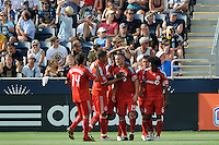 Chad Barrett (19) of Toronto FC celebrates scoring in the 81st minute. The Philadelphia Union defeated Toronto FC 2-1 on a second half stoppage time goal during a Major League Soccer (MLS) match at PPL Park in Chester, PA, on July 17, 2010.