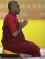 WINDSOR, ON. JULY 22, 2006. - Bharte (venerable) Rahula meditates during the Sanghadana service, a traditional way of showing respects to monks for preserving the teaching of the Buddha, at Linh Son Temple at 706 Goyeau Street Saturday July 22, 2006. A public talk about Vipassana Meditation was given at the temple for people interesting to learn about the technic.  (Windsor Star - Francis Vachon)<br />