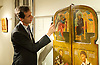Russian Art Week <br /> Rare Russian Icons in London <br /> <br /> Jan Morsink Ikonen's Russian Icons: Spirit &amp; Beauty exhibition <br /> at Trinity House, Maddox Street, London, Great Britain <br /> press photocall<br /> 21st November 2014 <br /> <br /> <br /> Simon Morsink of Jan Morsink Ikonen from Amsterdam, Holland with the Royal Doors - two panels at the centre of the iconostasis and connect the nave with the sanitary in the Russian Orthodox Church. <br /> <br /> Photograph by Elliott Franks <br /> Image licensed to Elliott Franks Photography Services