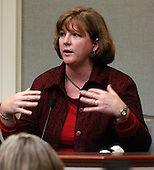 Spotsylvania County (Virginia) sniper victim, Caroline Seawell, gestures during her testimony in the trial of sniper suspect John Allen Muhammad in courtroom 10 at the Virginia Beach Circuit Court in Virginia Beach, Virginia on October 28, 2003. <br /> Credit: Adrin Snider - Pool via CNP