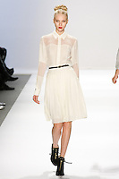 Yulia Lobova walks the runway in a Luca Luca Fall 2011 outfit, designed by Raul Melgoza, during Mercedez-Benz Fashion Week, February 10, 2011