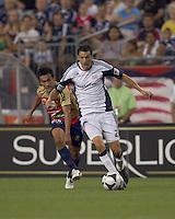 New England Revolution midfielder Marko Perovic (29) accelerates and Monarcas Morelia midfielder Ismael Pineda (6) pursues. Monarcas Morelia defeated the New England Revolution, 2-1, in the SuperLiga 2010 Final at Gillette Stadium on September 1, 2010.