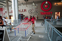Employees move shopping carts at the new Target store in the East Harlem neighborhood of New York on its opening day, Sunday, July 25, 2010. Target, which is the second largest discount retailer in the United States has opened its first permanent Manhattan location in the East River Plaza, a vertical mall. The company has projected revenue of $90 million in the stores first year of operation (© Richard B. Levine).