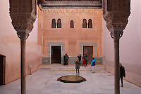Tourists in the Patio of the Gilded Room, between the Mexuar and the Gilded Room or Cuarto Dorado in the Comares Palace, built under Mohammed V in the 14th century, Alhambra, Granada, Andalusia, Southern Spain. The Alhambra was begun in the 11th century as a castle, and in the 13th and 14th centuries served as the royal palace of the Nasrid sultans. The huge complex contains the Alcazaba, Nasrid palaces, gardens and Generalife. Granada was listed as a UNESCO World Heritage Site in 1984. Picture by Manuel Cohen
