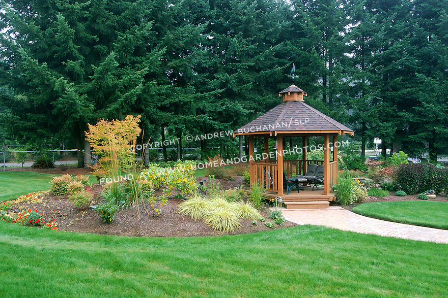 A gazebo offers a quiet retreat in this suburban back yard.
