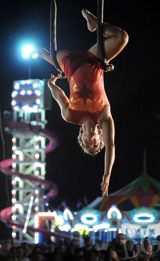 NWA Media/BEN GOFF  @NWABenGoff -- 08/16/14 Frances Flores of The Fearless Flores Thrill Show, based in Sarasota, Fla., performs a routine on the trapeze at the Benton County Fair near Bentonville on Saturday August 16, 2014.