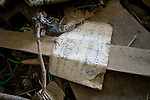 A post office document lies among the rubble inside the post office at Minami Sanriku, Japan on Tuesday 24 May 2011. .Photographer: Robert Gilhooly
