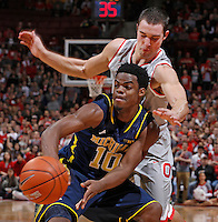 Ohio State Buckeyes guard Aaron Craft (4) plays tight defense against Michigan Wolverines guard Derrick Walton Jr. (10) in the second half at Nationwide Arena on February 11,  2014. (Chris Russell/Dispatch Photo)