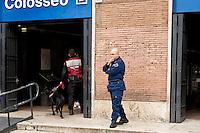 Roma 18 Novembre 2015<br /> Rafforzate le misure di sicurezza  pattuglie e controlli nelle stazioni metro e monumenti e 700 soldati armati in strada, in vista del giubileo, per allarme terrorismo, dopo gli attacchi coordinati da uomini armati e kamikaze a Parigi il 13 novembre che ha ucciso almeno 129 persone e rivendicati dallo Stato islamico. Sicurezza privata dell'Atac controlla la  stazione metro Colosseo con cane poliziotto.<br /> Rome 18 November 2015<br /> Strengthen security measures, checks in subway stations and monuments, 700 armed soldiers on the streets in view of the jubilee for terror alert after coordinated attacks by gunmen and suicide bombers in Paris on Nov. 13 that killed at least 129 people and claimed by the State Islamic. Private security ATAC (Tramways Company and Coach of the Municipality of Rome) controls the Colosseo metro station with a police dog.
