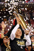 Ohio State Buckeyes head coach Urban Meyer hoists the trophy following their 42-20 win over Oregon in the College Football Playoff National Championship at AT&T Stadium in Arlington, Texas on Jan. 12, 2015. (Adam Cairns / The Columbus Dispatch)