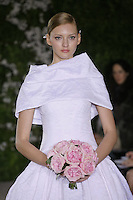 Model walks runway in an Anya wedding dresses by Carolina Herrera, for the Carolina Herrera Bridal Spring 2012 runway show.