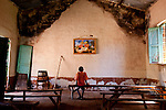 A boy stares at a painting of baby Jesus in a Catholic church in Tambura where the LRA has attacked twice on May 14, 2010.