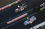 Jan. 21, 2012; Jupiter, FL, USA: Aerial view of NHRA funny car driver John Force (top) races alongside daughter Courtney Force during testing at the PRO Winter Warmup at Palm Beach International Raceway. Mandatory Credit: Mark J. Rebilas-