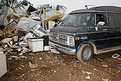 "Clunker, Raleigh Metal Recycling, Raleigh, N.C. - The highly popular ""Cash for Clunkers"" government stimulus program has run out of funds with no plans for further funding by the Obama administration. Nearly 500,000 sales have been made since July 24."