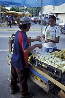 Snack vendor serving a customer in downtown San Pedro Sula, Honduras