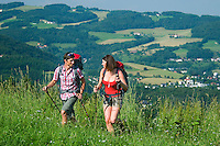 Linz, Danube, Upper Austria, June 2010. The Fores trail makes way for the rolling hills over the city of Linz. We end up on the Postlingberg viewpoint for some refreshing drinks. The 450 kilometre long Donausteig hiking trail roughly follows the Danube on both sides of the river between Passau in Germany and Grein in Austria. Photo by Frits Meyst/Adventure4ever.com
