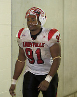Louisville Cardinals defensive tackle Amobi Okoye heads back to the locker room after the Louisville Cardinals defeated the Pitt Panthers 48-24 on November 25, 2006 at Heinz Field, Pittsburgh, Pennsylvania.