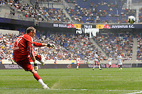 New York Red Bulls goalkeeper Greg Sutton (24) puts a ball into play. The New York Red Bulls defeated Juventus F. C. 3-1 during a friendly at Red Bull Arena in Harrison, NJ, on May 23, 2010.