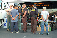 """Phoenix, Arizona. March 29, 2008 - The Maricopa County Sheriff's Office (MCSO) led by Sheriff Joe Arpaio conducted what they called the """"Bell Road Crime Suppression,"""" a two-day operation consisting of saturation patrol in the area of Bell Road and Cave Creek Road, in north Phoenix. According to MCSO, during the two-day crime suppression operation, sheriff's deputies and posse members arrested a total of 53 suspects who were taken into custody, 27 of which were reportedly illegally in the country. The remaining 26 arrests were U.S. citizens. The MCSO set their command center in the parking lot of a strip mall. People from the surrounding community, immigration advocates and organizers protested the sheriff's operation around the perimeter restricted by MCSO by yelling and display signs with a variety of messages against MCSO and Arpaio. Supporters of Sheriff Arpaio were also present at the protest. Both groups of protesters engaged in verbal confrontations. For activists, MCSO's """"crime suppression"""" operations are nothing but """"immigration raids,"""" where according to immigrant's advocates MCSO posse members and sheriff deputies engage in racial profiling to target and stop Latino motorists based on physical appearance features such as brown skin. Photo by Eduardo Barraza © 2008"""