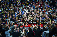 The Saracens team celebrate lifting the European Rugby Champions Cup trophy. European Rugby Champions Cup Final, between Saracens and Racing 92 on May 14, 2016 at the Grand Stade de Lyon in Lyon, France. Photo by: Patrick Khachfe / Onside Images