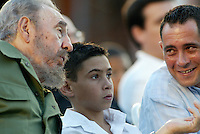 "The cuban President Fidel Castro, left, talk wiht Elian Gonzalez, center and his father Juan Miguel Gonzalez during the act  of commemoration the beginning of the called period ""Battles of Ideas"", Tuesday, November 5, 2005 in Cardenas City, Matanzas, Cuba.  Credit: Jorge Rey/MediaPunch"