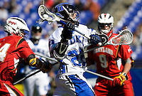 Ned Crotty (22) of Duke shoots past Brett Schmidt (44) of Maryland during the Face-Off Classic in at M&T Stadium in Baltimore, MD