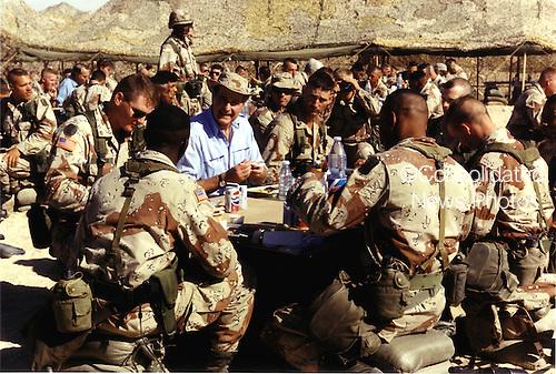 Saudi Arabia - November 22, 1990 -- United States President George H.W. Bush shares the holiday meal with United States military personnel in Saudi Arabia on Thanksgiving Day, November 22, 1990..Credit: David Valdez - WH via CNP