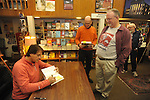 "Retired St. Louis Cardinals manager Tony La Russa signs copies of his book ""One Last Strike"" for Mickey McLaurin at Square Books in Oxford, Miss. on Thursday, November 29, 2012."