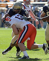 Pittsburgh defensive lineman Mick Williams sacks Syracuse quarterback Ryan Nassib (12). The Pittsburgh Panthers defeated the Syracuse Orange 37-10 at Heinz Field, Pittsburgh Pennsylvania on November 7, 2009..