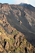 Valle del Bove, Mount Etna Volcano, Italy. Degassing Southeast Crater visible at top of image and volcanic dikes (sheetlike magma intrusions) visible at bottom.